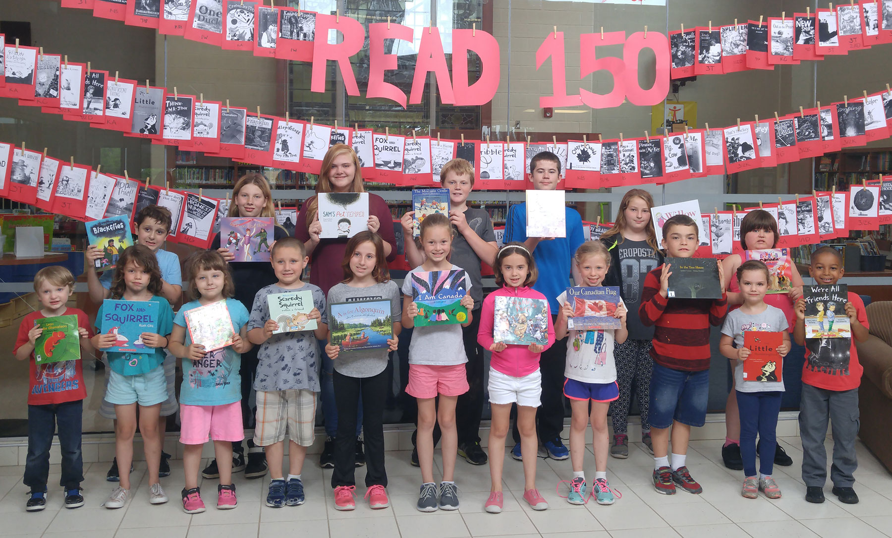 Pictured are some students from each division at Tweed Elementary School. The whole school participated in Read 150 where they read 150 books by Canadian authors during the month of June 2017.