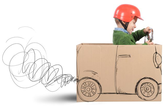 boy in a cardboard car